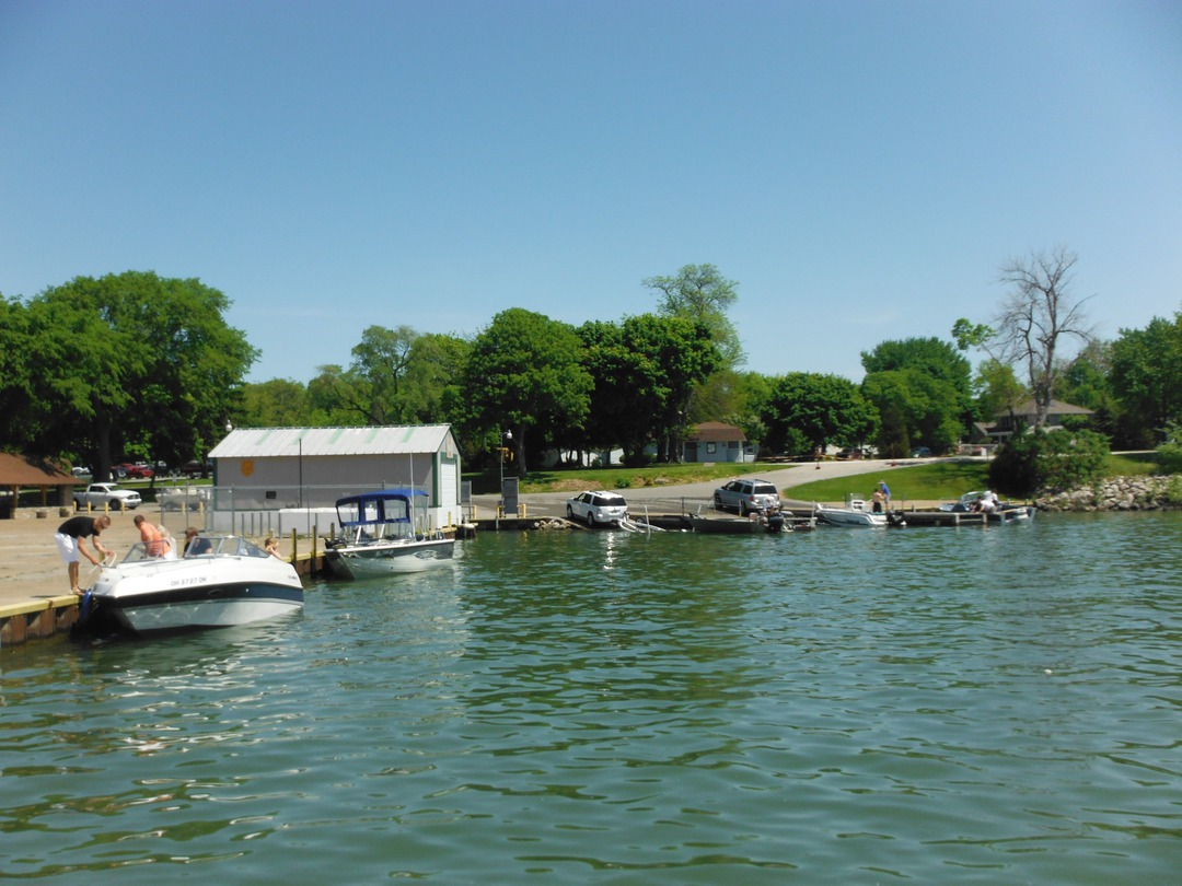 This is the boat ramp and dock at Catawba Island. ODNR rangers put in here     as well; note the ODNR shed toward the center left. In the background,     vehicles queue up to set their boats into the water. To the right of this     image is the Catawba Island Club harbor.